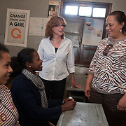 Congresswoman Laura Richardson, CA, meets with girls attending Biruh Tesfa in Addis Ababa, during the CARE Learning Tour trip to Ethiopia. Biruh Tesfa means bright future in Amharic, and is a program for urban adolescent girls at risk of exploitation and abuse. For many girls, going to Biruh Tesfa is their only hope of an education and a repite from their domestic work. ..The program promotes functional literacy, life skills, livelihoods skills, and HIV/reporductive health education through girls' clubs led by adult female mentors. The girls' clubs are held in meeting spaces donated by the kebele (local administration).