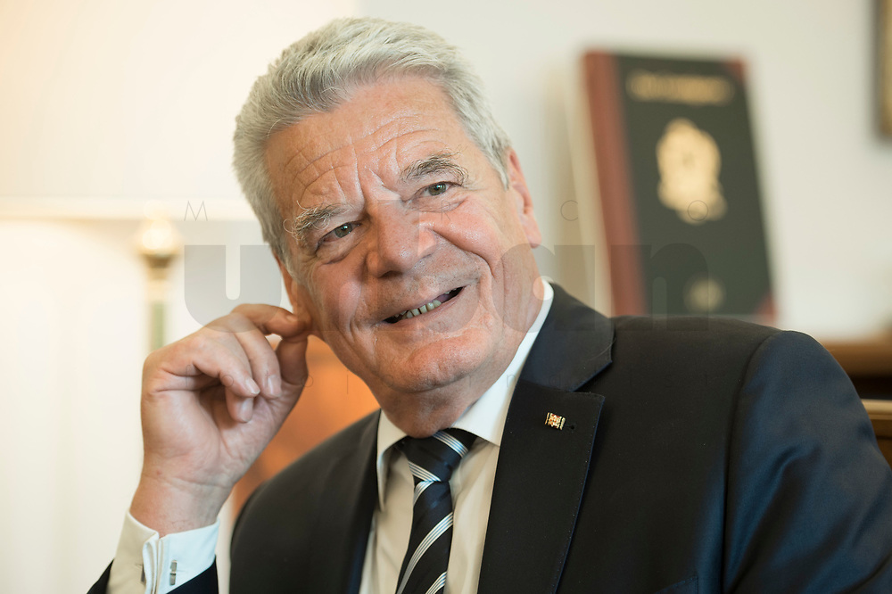 10 SEP 2014, BERLIN/GERMANY:<br /> Joachim Gauck, Bundespraesident, während einem Interview, im Amtszimmer des Bundespraesidenten, Schloss Bellevue<br /> IMAGE: 20141010-03-057<br /> KEYWORDS: Bundespräsident
