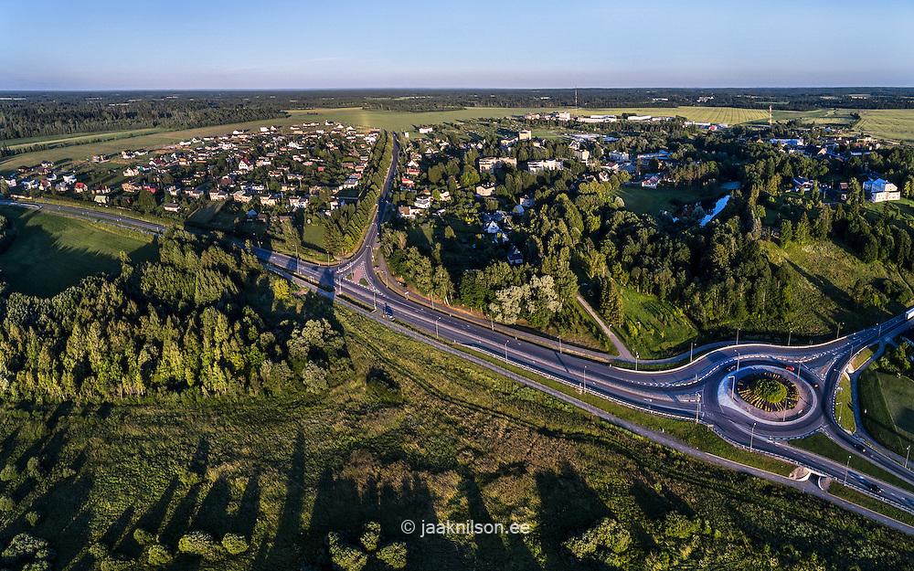 Dual carriageway near Viljandi. Viiratsi, Estonia. Aerial view, buildings, road, traffic circle. Suburb.