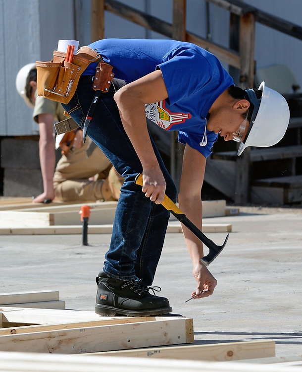 jt033117e/a sec/jim thompson/  CNM student Bryan Martin-Figueroa frames up a wall in the  SkillsUSA  competition on the CNM Main campus in Albuquerque, NM. Friday March 31, 2017. (Jim Thompson/Albuquerque Journal)