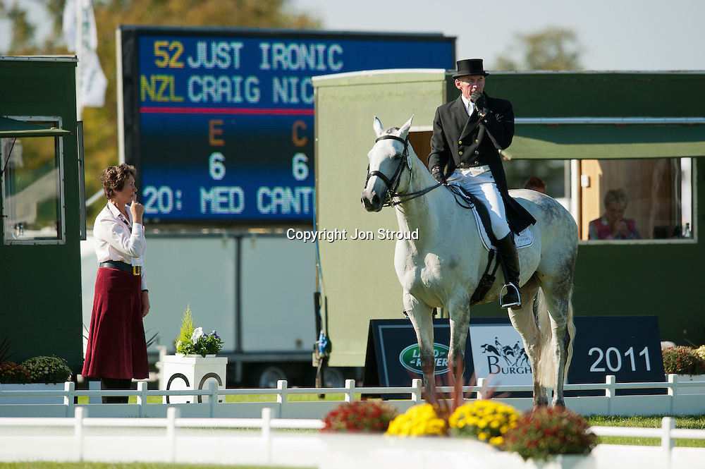 Craig Nicolai (NZL) & Just Ironic receive a little navigational help from judge Angela Tucker after a second error of course during their test - Dressage - The Land Rover Burghley Horse Trials - Stamford, Lincolnshire, United Kingdom - 1 September 2011