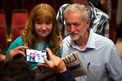 © Licensed to London News Pictures. 05/09/2015. Margate, UK.  JEREMY CORBYN posing for a photograph with a supporter after the event. Labour leadership candidate JEREMY CORBYN taking part in a rally in Margate in Kent, UK today (SAT).  Corbyn is currently the favourite to be announced as the new Labour party leader on September 12th. Photo credit: Ben Cawthra/LNP