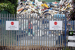 © Licensed to London News Pictures. 11/07/2014<br /> <br /> The Environment Agency has two officers posted out side the Waste4fuel site in Kent after local people reported seeing three lorry loads of waste being delivered on Monday (7.07.2014) to the St Pauls Cray site.  The Environment Agency has served an enforcement notice on Waste4Fuel to stop any further waste being brought into the site. <br /> This means any person depositing waste at Waste4Fuel will be committing an offence and may face action from the Environment Agency. <br /> Several conditions need to be met before further waste can be accepted at the site. <br /> The Environment Agency is waiting for a written decision from the High Court after it dismissed a contempt of court case last week for failure to maintain fire breaks and store new waste separately at the site. <br /> <br /> (Byline:Grant Falvey/LNP)