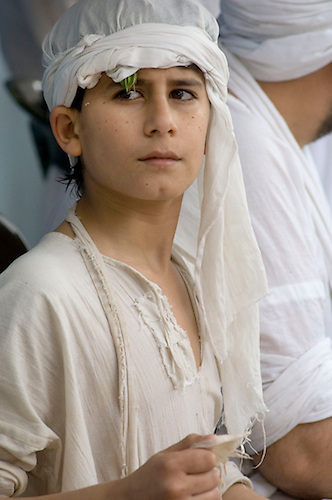 Iraqi Mandean Christian boy during baptism ceremony, Damascus, Syria..Photograph by John Wreford.9th May 2010