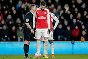 Olivier Giroud (Arsenal) is spoken to by Kevin Friend (referee) during the The FA Cup fifth round match between Hull City and Arsenal at the KC Stadium, Kingston upon Hull, England on 8 March 2016. Photo by Mark P Doherty.