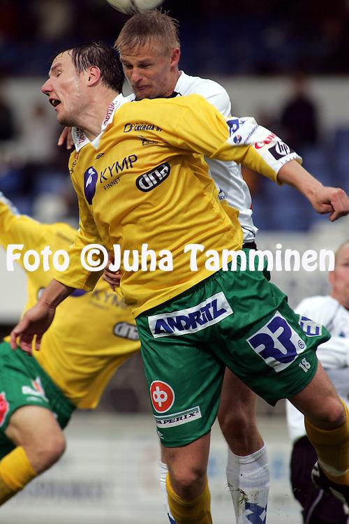 28.08.2005, Tehtaankentt?, Valkeakoski, Finland..Veikkausliiga 2005 / Finnish League 2005.FC Haka v FC KooTeePee.Juha Pasoja (Haka) v Kim Liljeqvist (KooTeePee).©Juha Tamminen.....ARK:k