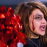 110113       Cable Hoover<br /> <br /> Cheerleader Tonia Cooper dons zombie makeup for Friday's bout between the Grants Pirates and the Gallup Bengals at Grants High School.