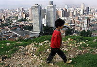 A young boy walks on the side of a road above Bogotá. (Photo/Scott Dalton)