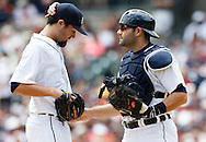 May 22, 2014; Detroit, MI, USA; Detroit Tigers catcher Alex Avila (13) talks to starting pitcher Robbie Ray (38) during the game against the Texas Rangers at Comerica Park. Mandatory Credit: Rick Osentoski-USA TODAY Sports
