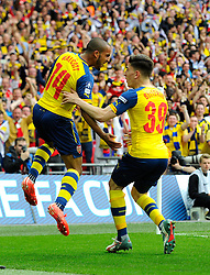 Arsenal's Theo Walcott celebrates scoring the opening goal of the game with Arsenal's Hector Bellerin  - Photo mandatory by-line: Joe Meredith/JMP - Mobile: 07966 386802 - 30/05/2015 - SPORT - Football - London - Wembley Stadium - Arsenal v Aston Villa - FA Cup Final