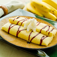 Banana Blintz with chocolate sauce and whipped cream