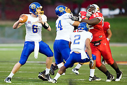 24 September 2011: Josh Kage holds back Albert Sparks for quarterback Austin Summer during an NCAA football game between the South Dakota State Jackrabbits (SDSU) and the Illinois State Redbirds (ISU) at Hancock Stadium in Normal Illinois.