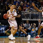 15 March 2018: San Diego State Aztecs guard Jeremy Hemsley (42)sticks to Houston Cougars guard Rob Gray (32) in the first half. The San Diego State Aztecs got knocked out in the first round by Houston on a last second layup to lose 67-65  at Intrust Bank Arena in Wichita, Kansas.
