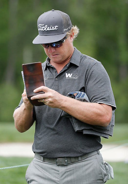 Charley Hoffman checks his scorecard while walking to the 9th tee box during the second round of the Shell Houston Open golf tournament at the Golf Club of Houston on , Friday, April 1, 2016, in Humble, Texas.  (Photo: Thomas B. Shea/For the Chronicle)