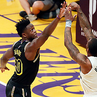 30 March 2018: Milwaukee Bucks guard Eric Bledsoe (6) takes a jump shot over Los Angeles Lakers forward Julius Randle (30) during the Milwaukee Bucks 124-122 victory over the LA Lakers, at the Staples Center, Los Angeles, California, USA.
