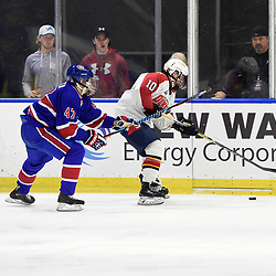 BUFFALO, NY - SEP 20,  2017: Ontario Junior Hockey League Governors Showcase game between the Toronto Jr. Canadiens and Wellington Dukes, Anton Trublin #47 of the Toronto Jr. Canadiens tries to keep the puck from Graeme McCrory #10 of the Wellington Dukes during the second period.<br /> (Photo by Andy Corneau / OJHL Images)