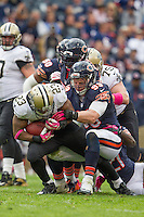 06 October 2013: Running back (23) Pierre Thomas of the New Orleans Saints runs the ball and is tackled by (99) Shea McClellin of the Chicago Bears during the second half of the Saints 26-18 victory over the Bears in an NFL Game at Soldier Field in Chicago, IL.