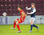FYR Macedonia's David Babunski and Scotland's Craig Slaterduring Scotland Under-21 v FYR Macedonia,  UEFA Under 21 championship qualifier  at Tynecastle, Edinburgh. Photo: David Young<br /> <br />  - © David Young - www.davidyoungphoto.co.uk - email: davidyoungphoto@gmail.com