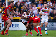 Bradford Bulls winger Iliness Macani (5) is tackled during the Kingstone Press Championship match between Dewsbury Rams and Bradford Bulls at the Tetley's Stadium, Dewsbury, United Kingdom on 4 June 2017. Photo by Simon Davies.