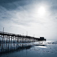 Photo of Newport Pier in Newport Beach. Newport Pier is located along the Pacific Ocean at 21st Place and Oceanfront Boulevard on Balboa Peninsula in Newport Beach, Orange County, California.