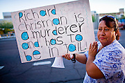 11 OCTOBER 2010 - PHOENIX, AZ:  JOSEFINA, from Phoenix, pickets the Phoenix police headquarters Monday night. About 300 people gathered at the Phoenix Police Department headquarters building Monday night to protest the shooting of Daniel Rodriguez and his dog. The officers responded to a 911 call made by Rodriguez' mother. A scuffle ensued when they arrived and Phoenix police officer Richard Chrisman shot Rodriguez, who was unarmed, and his dog. Chrisman then allegedly filed a false report about the event. He has been arrested on felony assault charges. The event has angered some in the Latino community and they have held a series of protests at the police headquarters. They want Chrisman charged with murder.    Photo by Jack Kurtz
