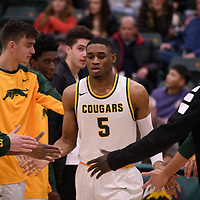 5th year guard Brandon Tull (5) of the Regina Cougars in action during the home opener on November  10 at Centre for Kinesiology, Health and Sport. Credit: Arthur Ward/Arthur Images