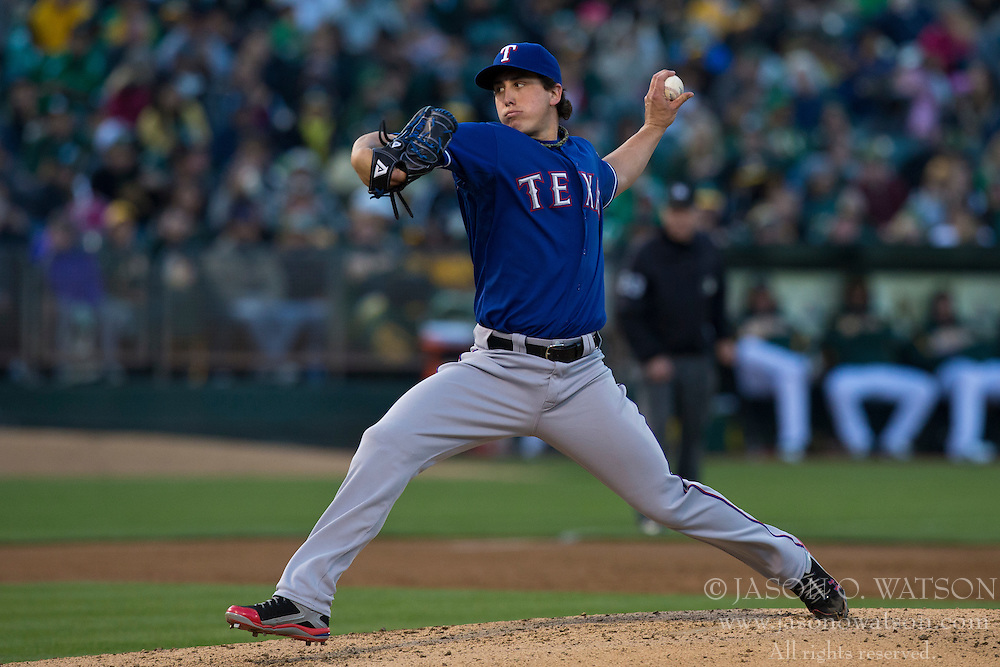 OAKLAND, CA - MAY 14: Derek Holland #45 of the Texas Rangers pitches against the Oakland Athletics during the third inning at O.co Coliseum on May 14, 2013 in Oakland, California. The Texas Rangers defeated the Oakland Athletics 6-5 in 10 innings. (Photo by Jason O. Watson/Getty Images) *** Local Caption *** Derek Holland