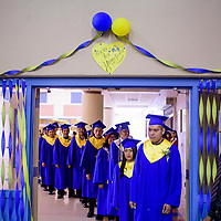 052215       Cable Hoover<br /> <br /> Class of 2015 seniors line up outside the gym for their commencement ceremony Friday at Zuni High School.