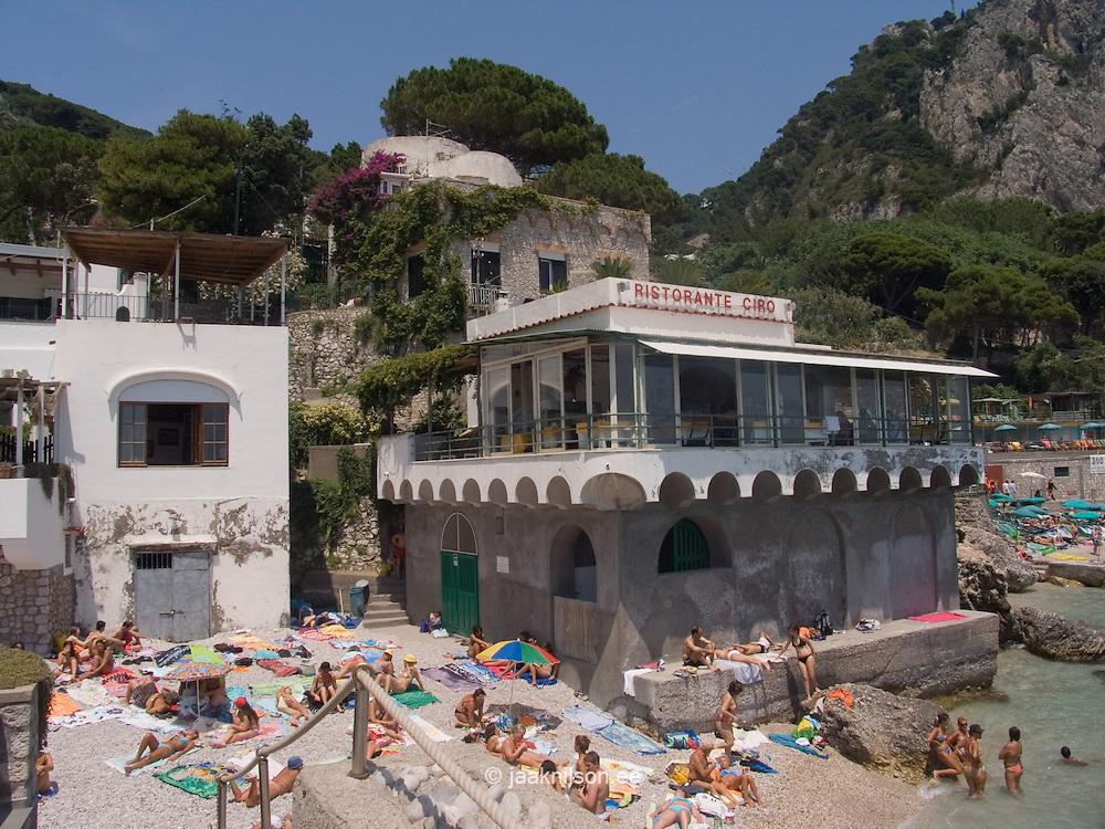 Sunbathers on beach at Marina Piccola, Capri Island, Italy