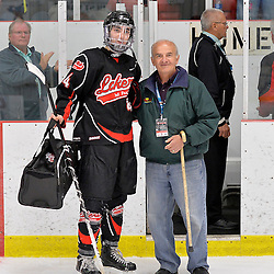 """FORT FRANCES, ON - May 1, 2015 : Central Canadian Junior """"A"""" Championship, game action between the Fort Frances Lakers and the Toronto Patriots, semi-final game of the Dudley Hewitt Cup. Dylan Robertson #44 of the Fort Frances Lakers receives the player of the game award.<br /> (Photo by Shawn Muir / OJHL Images)"""