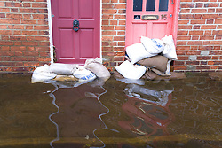 Sandbags propped up outside front doors after torrential rain caused flooding in Oxford and the Thames Valley area; July 2007,