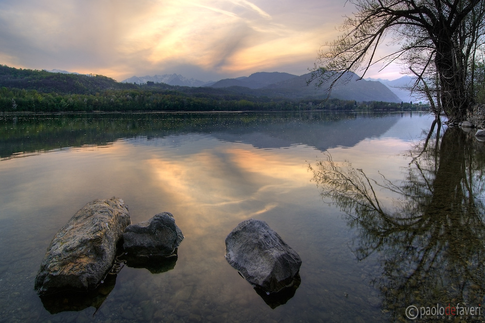 a view of the Avigliana lake at sunset. Stitch of three vertical takes