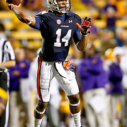 Sep 21, 2013; Baton Rouge, LA, USA; Auburn Tigers quarterback Nick Marshall (14) throws a pass against the LSU Tigers during the second half of a game at Tiger Stadium. LSU defeated Auburn 35-21. Mandatory Credit: Derick E. Hingle-USA TODAY Sports
