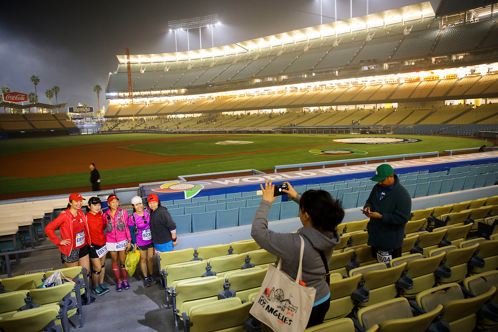 "Runners take photos inside Dodger Stadium before the start of the 32nd annual Los Angeles Marathon at Dodger Stadium on Sunday morning, March 19, 2017 in Los Angeles, Calif.  The 26.2-mile ""Stadium to the Sea"" route begins at Dodger Stadium and ends at Ocean and California avenues in Santa Monica. © 2017 Patrick T. Fallon"