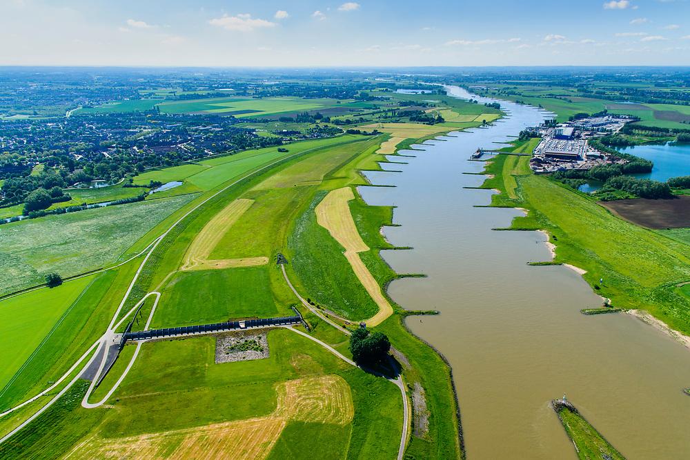 Nederland, Gelderland, Arnhem, 29-05-2019; IJsselkop, splitsing Nederrijn in Nederrijn naar Arnhem en IJssel. Foto riichting Duitsland. Naast de IJsselkop ligt de Hondsbroeksche Pleij, voormalige uiterwaard, nu een van de Ruimte voor de Rivier lokaties.  Het Regelwerk draagt zorg voor de verdeling van het rivier water bij hoogwater.<br /> IJsselkop, junction Nederrijn in Nederrijn to Arnhem and IJssel. Next to the IJsselkop is the Hondsbroeksche Pleij, former flood plain, now one of the Room for the River locations. Highwater arrangment  is responsible for the distribution of river water at high water.<br /> <br /> luchtfoto (toeslag op standard tarieven);<br /> aerial photo (additional fee required);<br /> copyright foto/photo Siebe Swart