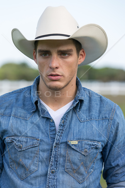 portrait of a good looking cowboy outdoors