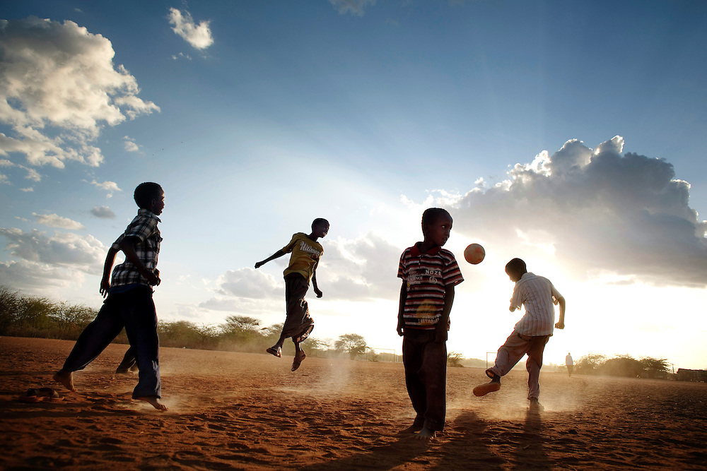 Dadaab, Kenya. .Dadaab is the largest refugeecamp in the world and it inhabits almost 500000 refugees. Tha camp has grown the last year because of the draught on the Horn of Africa. 1000-1500 people everyday arrives to Dadaab in search for relief. Here young boys are playing fotball.