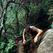 A man run on the trails of Olomana Mountain near Honolulu, on the island of Oahu, Hawaii.