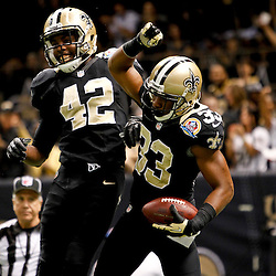 December 16, 2012; New Orleans, LA, USA; New Orleans Saints cornerback Jabari Greer (33) celebrates following an interception with teammate free safety Isa Abdul-Quddus (42) during the second half of a game against the Tampa Bay Buccaneers at the Mercedes-Benz Superdome. The Saints defeated the Buccaneers 41-0. Mandatory Credit: Derick E. Hingle-USA TODAY Sports