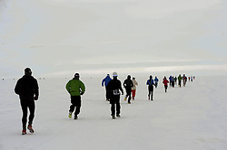 © Licensed to London News Pictures. Union Glacier, Antarctica. Athletes compete in the 9th edition of the Antarctic Ice Marathon. The Ice Marathon took place at Union Glacier, Antarctica, and is  recognised as the world's southernmost marathon and the only official running event within the Antarctic Circle, taking place just a few hundred miles from the South Pole at the foot of the Ellsworth Mountains. Temperatures were an ice cool -21C when the event got underway at 13:10 GMT on Wednesday 20  November. A total of 56 athletes from 21 countries took part in the ninth edition of the event, which is  an essential race for marathon runners seeking to join the Seven Continents Marathon Club. Photo credit: Mike King/LNP