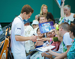 LONDON, ENGLAND - Tuesday, June 23, 2009: Andy Murray (GBR) signs autographs for fans after his Gentlemen's Singles 1st Round victory on day two of the Wimbledon Lawn Tennis Championships at the All England Lawn Tennis and Croquet Club. (Pic by David Rawcliffe/Propaganda)