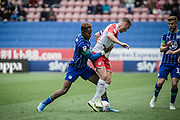 Wigan Jamal Lowe presses for the ball during the EFL Sky Bet Championship match between Wigan Athletic and Barnsley at the DW Stadium, Wigan, England on 31 August 2019.