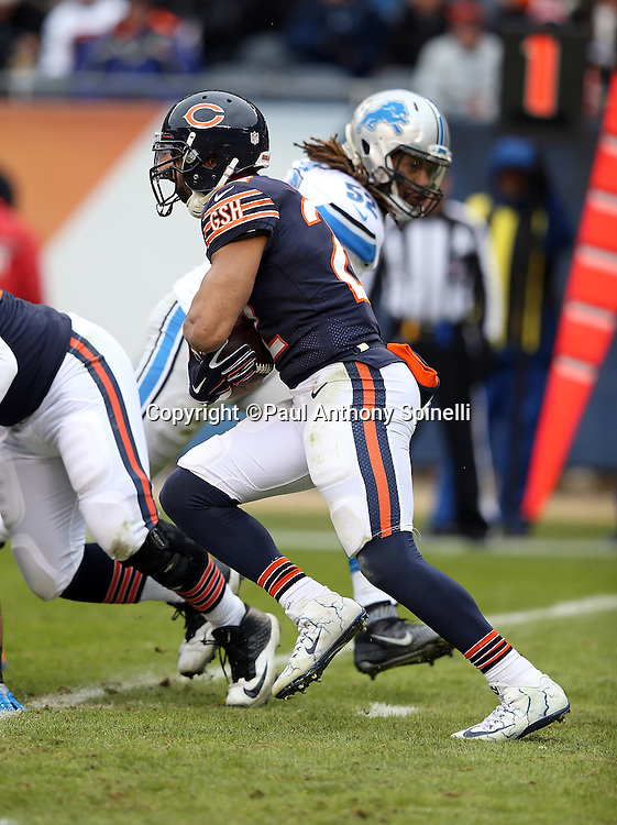 Chicago Bears running back Matt Forte (22) runs the ball during the NFL week 17 regular season football game against the Detroit Lions on Sunday, Jan. 3, 2016 in Chicago. The Lions won the game 24-20. (©Paul Anthony Spinelli)