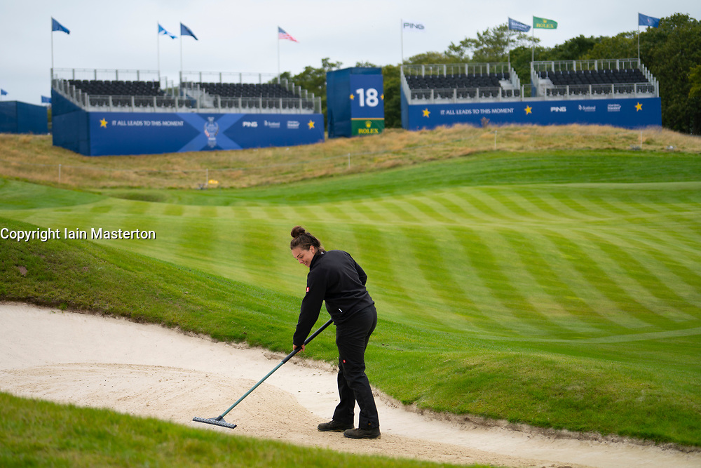 Auchterarder, Scotland, UK. 8 September 2019.  Final preparations underway at the Centenary Course at Gleneagles for the 2019 Solheim Cup between women golfers from Europe and the USA. The event runs from 9-15 September. Pictured; Sophie, a greenkeeper from Berkshire, rakes a bunker on the 18th hole. Iain Masterton/Alamy Live News
