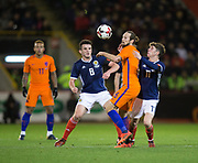 9th November 2017, Pittodrie Stadium, Aberdeen, Scotland; International Football Friendly, Scotland versus Netherlands; Scotland's Daley Blind battles for the ball with Scotland's John McGinn and Ryan Christie