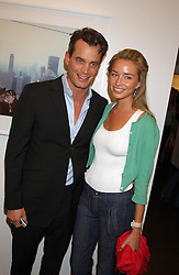 MATTHEW MELLON and NOELLE RENO at a party to celebrate the opening of an exhibition of photographs by the late Norman Parkinson held at Hamiltons gallery, 13 Carlos Place, London W1 on 14th September 2004.<br /><br />NON EXCLUSIVE - WORLD RIGHTS