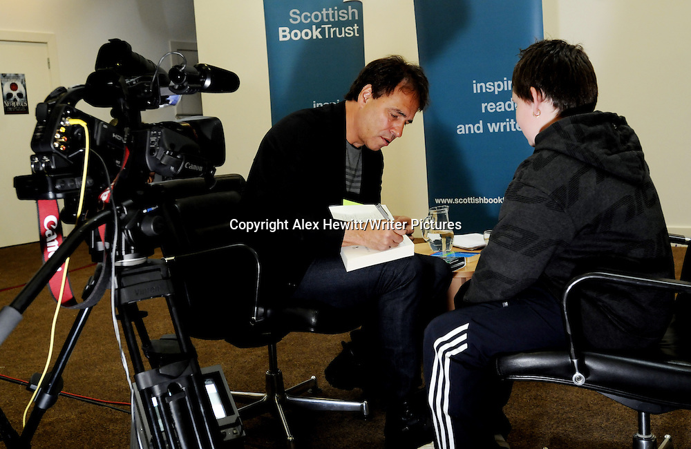 Anthony Horowitz discusses his latest book Necropolis in front of an audience of Edinburgh Schoolchildren while simultaneously being broadcast over the internet to over 10000 school children around Scotland<br /> <br /> Copyright Alex Hewitt/Writer Pictures <br /> contact +44 (0)20 8224 1564<br /> sales@writerpictures.com <br /> www.writerpictures.com
