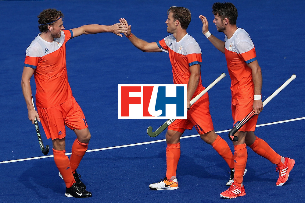 RIO DE JANEIRO, BRAZIL - AUGUST 09:  Jeroen Hertzberger #11 (C) of Netherlands high fives Bob de Voogd #10 after Hertzberger scored a goal against Canada during the hockey game on Day 4 of the Rio 2016 Olympic Games at the Olympic Hockey Centre on August 9, 2016 in Rio de Janeiro, Brazil.  (Photo by Christian Petersen/Getty Images)