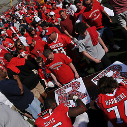 Apr 18, 2009; Piscataway, NJ, USA; Rutgers OL Anthony Davis (75) and Howard Barbieri (74) sign autographs for fans following Rutgers' Scarlet and White spring football scrimmage.
