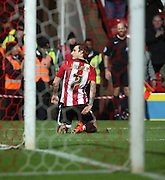 Brentford midfielder Sam Saunders celebrating scoring opening goal during the Sky Bet Championship match between Brentford and Leeds United at Griffin Park, London, England on 26 January 2016. Photo by Matthew Redman.